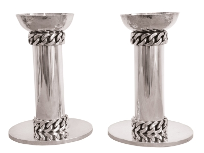JEAN DESPRES, Pair of candlesticks, 60s